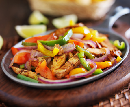 cast iron pan: mexican chicken fajitas in iron skillet with peppers