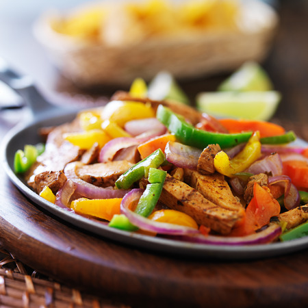 skillet: mexican chicken fajitas in iron skillet with peppers