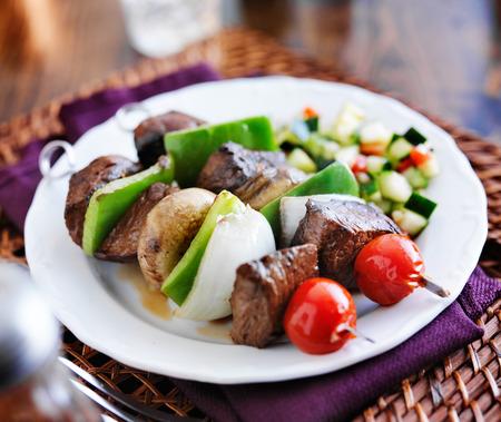 shishkabab: steak and vegetable shishkabob skewers with cucumber salad