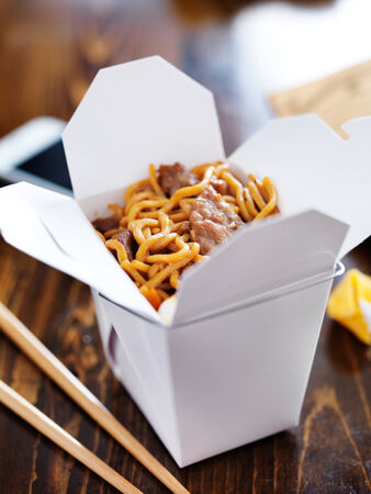 chinese noodle: chinese take out with smart phone on table and menu
