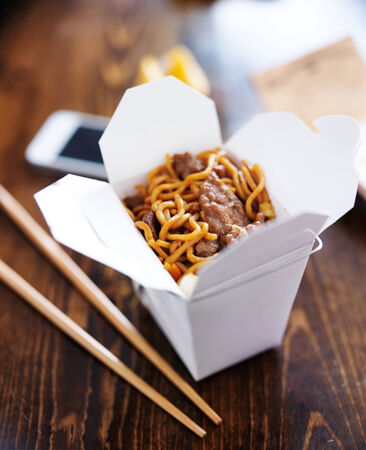 take away: chinese take out with smart phone on table and menu