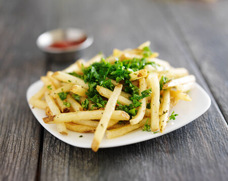 plate of truffle fries with parsley spread