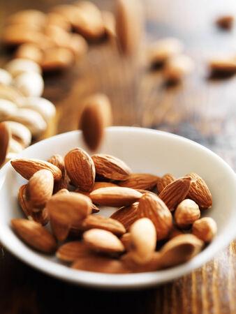 almonds falling into bowl Stock Photo - 31067698