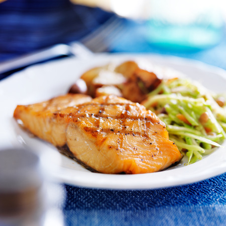 grilled salmon with asian slaw and roasted potatoes Imagens