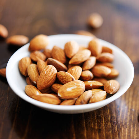 bowl of almonds shot with selective focus