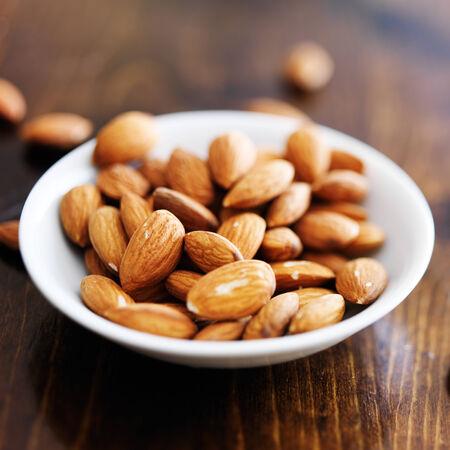 bowl of almonds shot with selective focus Stok Fotoğraf - 31067714