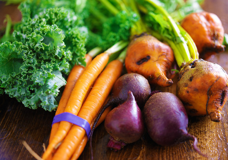 pile of veggies with carrots, beets and kale Stock Photo