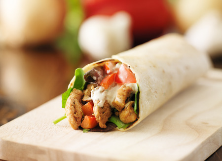 chicken wrap in tortilla with sauce and mesclun mix Stock fotó