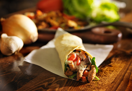 spicy chicken: spicy chicken wrap shot in panorama Stock Photo