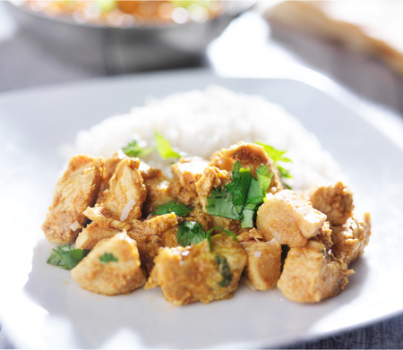 plate of indian butter chicken curry with basmati rice Stock Photo