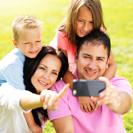 family taking selfie with smartphone photo