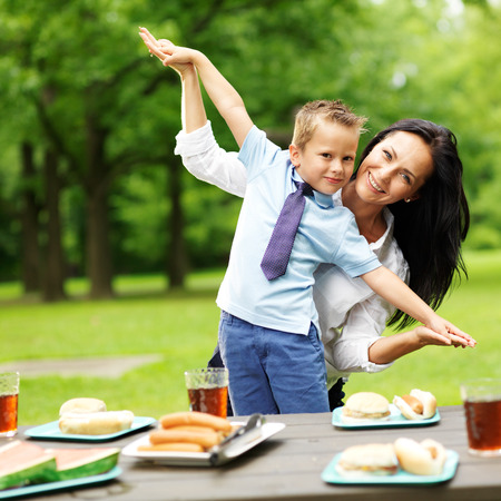 mother and son at picnic in park Stock Photo
