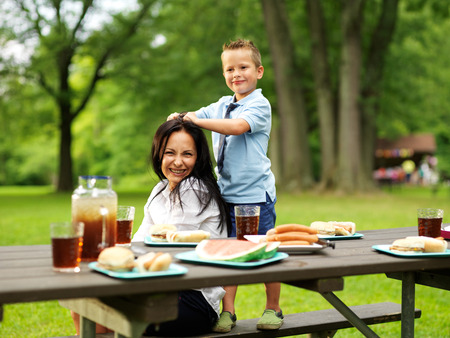 picnic table: mother and son at picnic in park Stock Photo