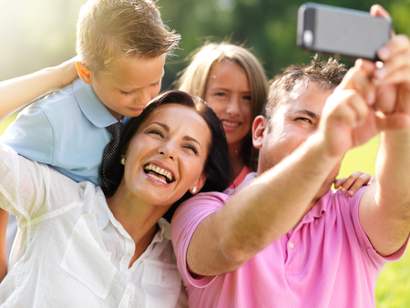 father taking selfie with family Stock Photo