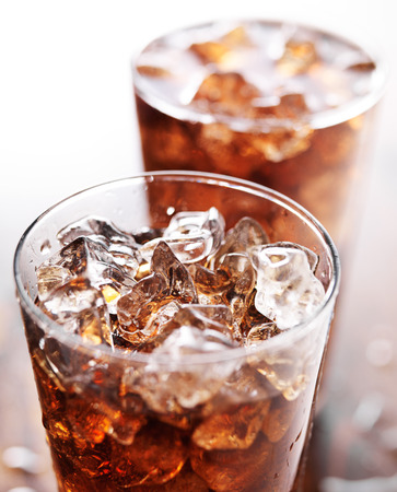 the carbonation: glass cup of cola soda with ice Stock Photo