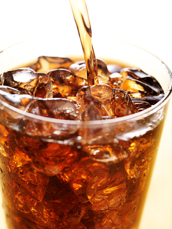 cola in glass cup with soft drink splash photo