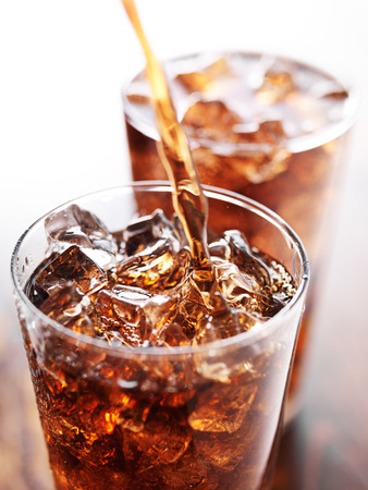 carbonated drink: soft drink being poured into glass Stock Photo
