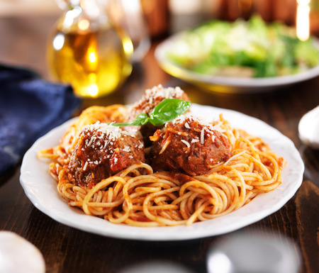 spaghetti dinner: italian food - spaghetti and meatballs at dinner table