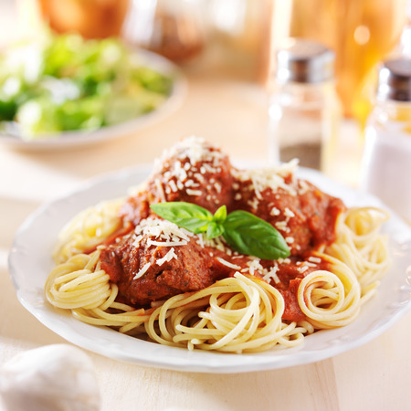 spaghetti and meatball dinner with salad photo
