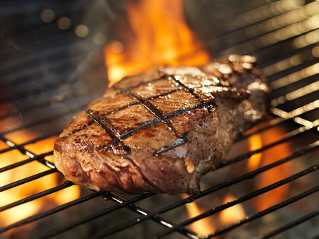 charcoal grill: steak with cooking on grill Stock Photo