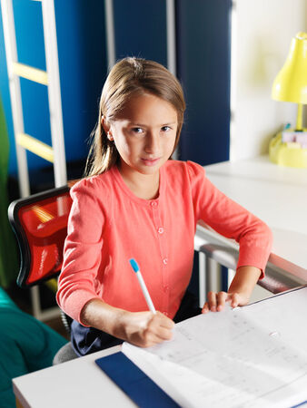 work from home: little girl doing home work for school Stock Photo