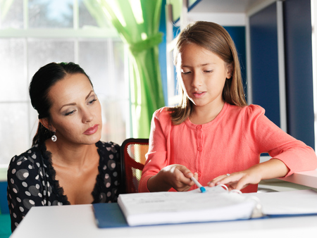 tutoring: mother helping daughter with homework