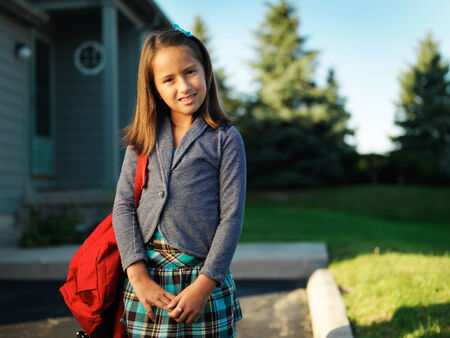 little girl portrait on way to school photo