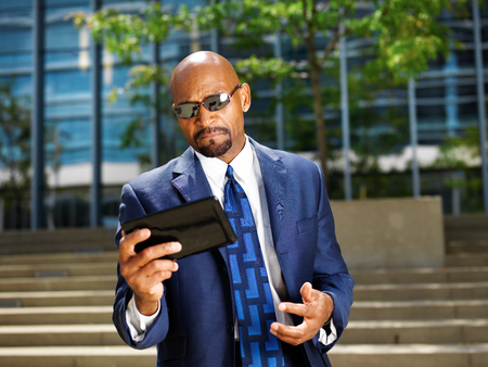 cool professional business executive working with tablet photo
