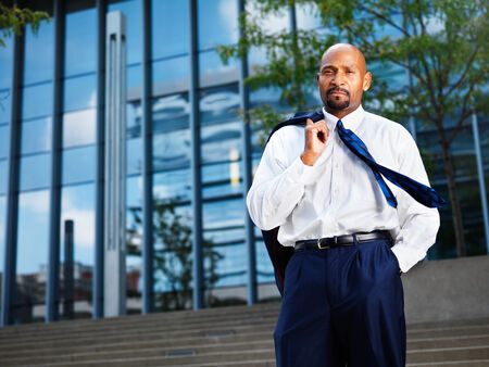 african businessman: mature african businessman looking off in distance Stock Photo
