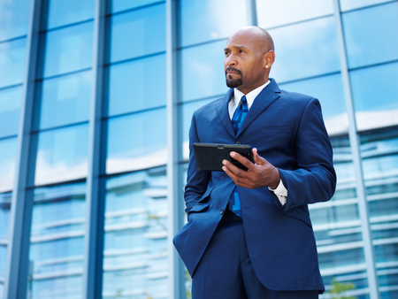 mature african american businessman working on tablet photo