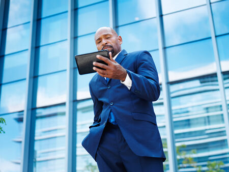 african businessman working on a tablet photo