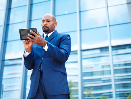 african american businessman using tablet photo