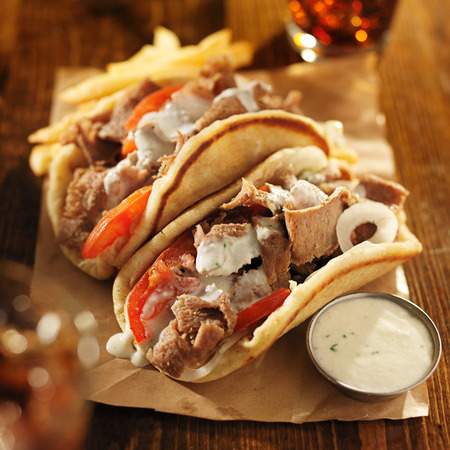greek gyros with tzatziki sauce, cola and fries