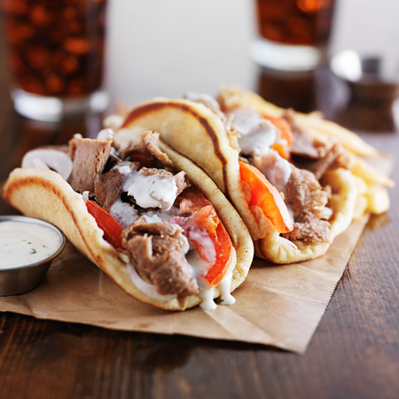 greece: authentic greek gyros with tzatziki sauce, cola and fries