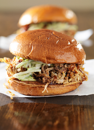 pulled: two pulled pork barbecue sandwiches close up