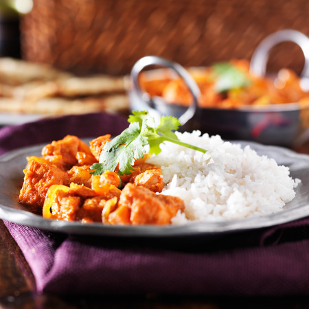 indian chicken vindaloo curry with basmati rice photo