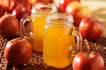 mason jars filled with hot apple cider