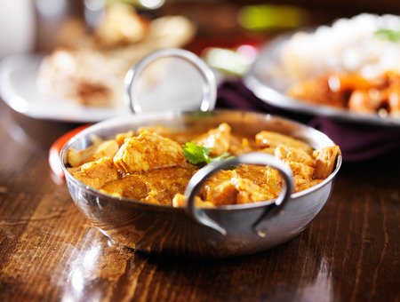 indian butter chicken curry with basmati rice photo