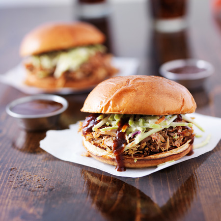 pulled pork barbecue sandwiches with condiment cups photo