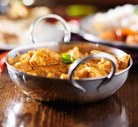 close up food: indian butter chicken curry with basmati rice