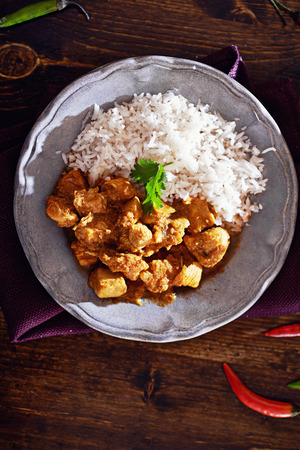 overhead view of indian chicken curry on plate with copyspace Stock Photo