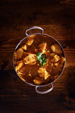 india food: overhead photo of a batli dish with indian butter chicken curry