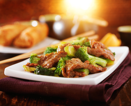 cuisine: chinese beef and broccoli  stir fry in warm light Stock Photo