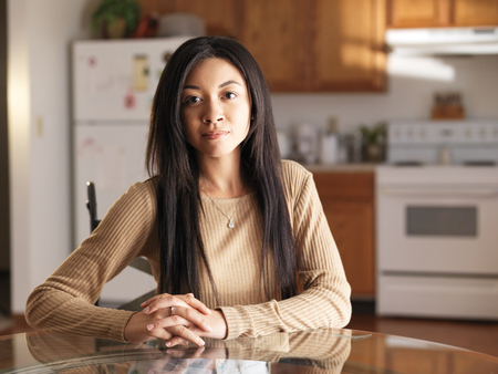 african american teen girl sitting at kitchen table portrait photo