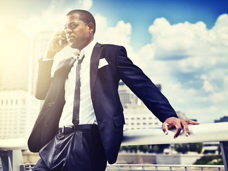 calling: african man on smartphone in suit;