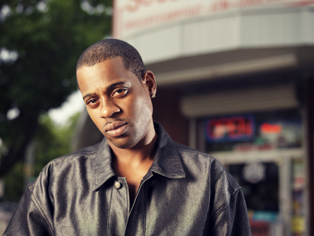 black rapper: cool african man in front of corner store in ghetto Stock Photo