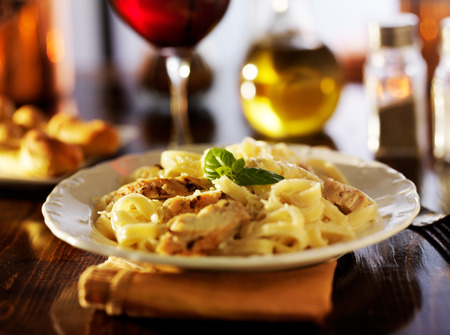 fettuccine alfredo with grilled chicken dinner at night Stock Photo