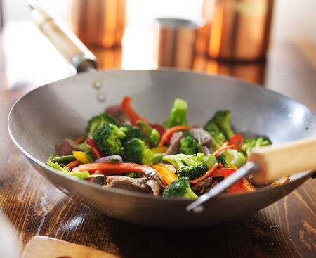 red food: asian wok with beef and vegetable stir fry Stock Photo