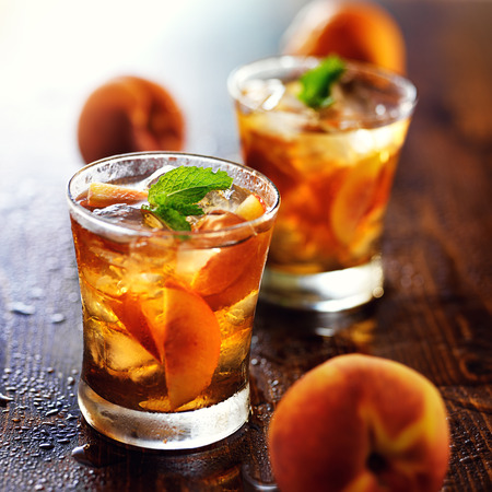 ice cold: two glasses of sweet peach iced tea