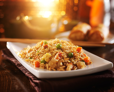 close up food: chinese fried rice on plate with orange glow
